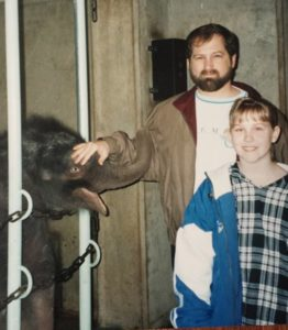 "My dad and me with my ""first-born"", Raja the elephant."